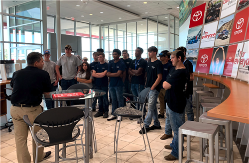 Large group of students at a Toyota dealership
