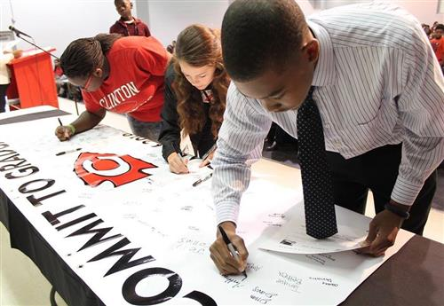 Students sign a pledge committing to graduate on time from Clinton High School