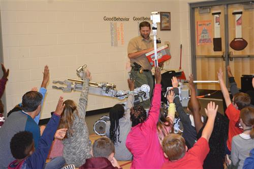 Students learn about robots used by the bomb squad