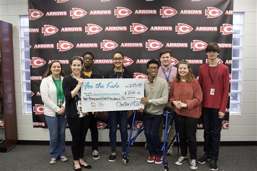 CHS students (group) present a check