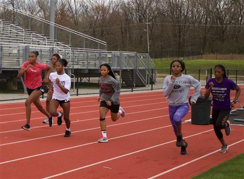 Lady Arrows track team running (large group)