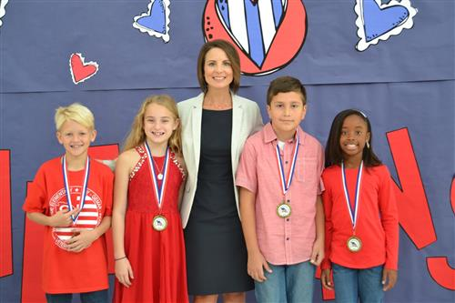 Four Northside students with Principal Mandy Ambrose