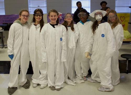 Lovett students in Hazmat suits (group)